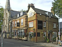 Enfield, The Stag Public House with Trinity Church, London © Christine Matthews